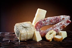 Assortment of cheese and salami Stock Photos