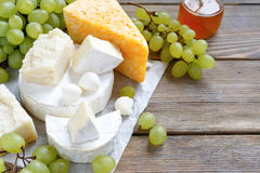 Assortment of cheeses on the boards Stock Photography