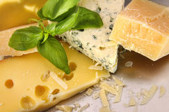 An assortment of cheeses on counter Stock Photo
