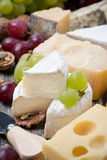 Assortment of cheeses and grapes, close-up Royalty Free Stock Images