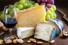 Assortment of cheeses with red wine. Royalty Free Stock Photos