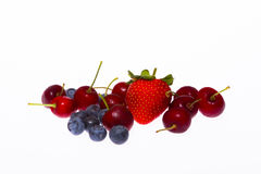 Assortment of cherries and berries stock images