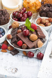 assortment chocolate, berries and nuts on white background Royalty Free Stock Image