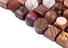 Assortment of chocolate candies and pralines. Assortment of sweet confectionery with chocolate candies and pralines Royalty Free Stock Photography