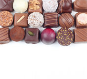 Assortment of chocolate candies and pralines. Assortment of sweet confectionery with chocolate candies and pralines Stock Image