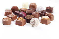 Assortment of chocolate candies and pralines. Assortment of sweet confectionery with chocolate candies and pralines Stock Photos