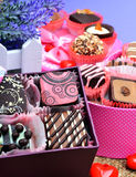 Assortment of chocolate sweets in gift boxes, lavender Royalty Free Stock Photo