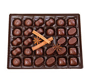 Assortment of chocolates in a plastic box close-up  on a white background. Stock Photos