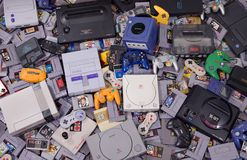 Assortment of Classic Retro Video Game Cartridges, Systems and Controllers royalty free stock photo