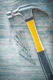 Assortment of claw hammer nails on wooden board construction con royalty free stock photos