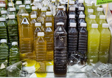 Assortment of cold tropical fruit juice in bottles. Royalty Free Stock Photography