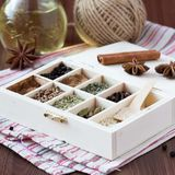 Assortment collection of spices and herb in wooden box, food Stock Image