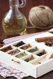 Assortment collection of spices and herb in wooden box, food Stock Photos