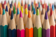 Assortment of Colored drawing pencils in a variety of colors macro stock photography