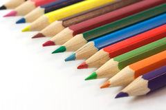 Assortment of colored pencils in row Stock Photos