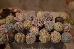 Assortment of colorful bite-sized bonbon or cake pops with sprinkles, with selective focus stock images
