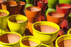 Assortment of colorful clay pots Stock Photos
