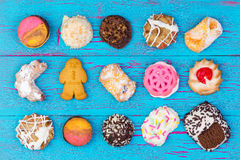 Assortment of colorful cookies on blue wood Stock Images