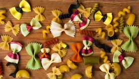Assortment of colorful pasta on wooden background,italian food Stock Images