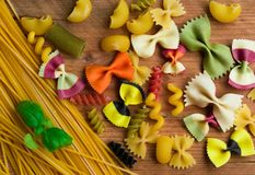 Assortment of colorful pasta on wooden background,italian food Royalty Free Stock Images
