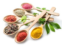 Assortment of colorful spices in the wooden spoons. On the white background Royalty Free Stock Photos