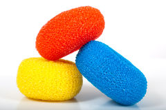 Assortment of colorful sponges. An assortment of colorful scrubbers or sponges on a white background Stock Photo