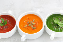 Assortment of colorful vegetable cream soup on white background Royalty Free Stock Images