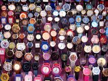 An assortment of colorful wrist watches. ANGONO, RIZAL, PHILIPPINES - DECEMBER 21, 2016: An assortment of colorful wrist watches sold at a bazaar stall Royalty Free Stock Photography
