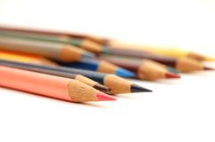Assortment of coloured pencils on white background Royalty Free Stock Photography