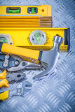 Assortment of construction tooling on channeled metal background stock photo