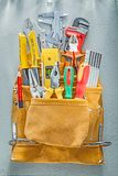 Assortment of construction tooling in tool belt on concrete back royalty free stock images