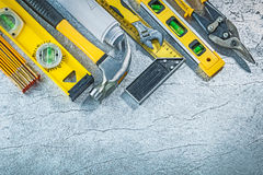 Assortment of construction tools on abstract metallic background royalty free stock image