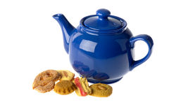 Assortment cookies with tea pot Royalty Free Stock Image
