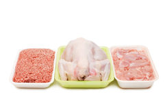 Assortment of crude meat in trays isolated Royalty Free Stock Image