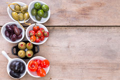 Assortment of cured olives and peppers Royalty Free Stock Image