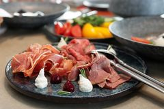 Assortment of cured and smoked meats and roast beef Stock Photo