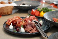 Assortment of cured and smoked meats and roast beef Royalty Free Stock Photos