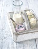 Assortment of dairy products. On the wooden table Royalty Free Stock Photo