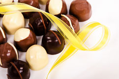 Assortment of dark and white chocolate candies Royalty Free Stock Photography