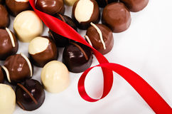 Assortment of dark and white chocolates Stock Images