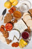 Assortment of delicacy cheeses and snacks, vertical top view. Assortment of delicacy cheeses and snacks, top view Stock Photography