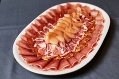 Assortment of delicatessen cold meat, salami, ham and bacon Royalty Free Stock Photography