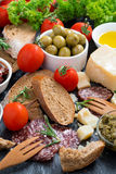 Assortment of delicious antipasti, vertical Royalty Free Stock Images