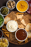 Assortment delicious appetizers with different sauces, top view Stock Photo