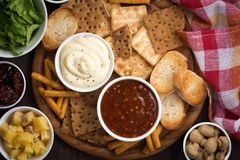 Assortment delicious appetizers with sauces, top view Stock Photos