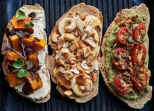 Assortment of delicious open faced sandwiches sitting in a skillet Stock Photos