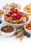 Assortment of different breakfast cereal, dried fruit and berry Stock Photos