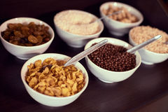 Assortment of different breakfast cereal and dried fruit on wooden table Stock Images