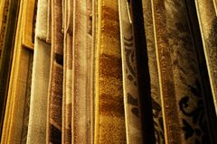 Assortment of different carpets in store. close up. Sale-Assortment of different carpets in store.Close up stock photography