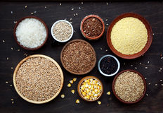 Assortment of different cereals and seeds in bowl: wheat, oats, barley, rice, millet, buckwheat, corn. Stock Photos